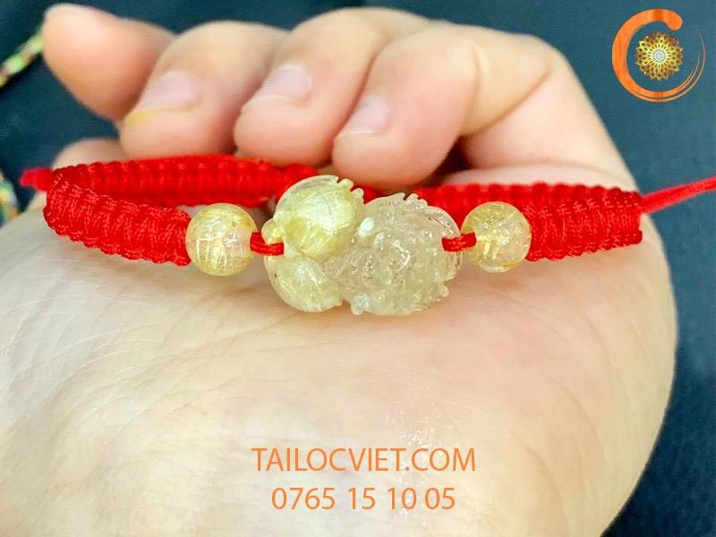 Vòng tay Tỳ Hưu tóc vàng tết dây đỏ
